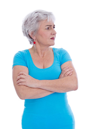 sideways: Angry pensive older woman looking sideways - isolated over white.