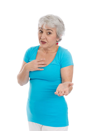 Isolated senior woman searching arguments gesturing with her hands.