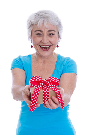 Happy isolated older woman holding a gift box in her hands. Stock Photo - 27626745