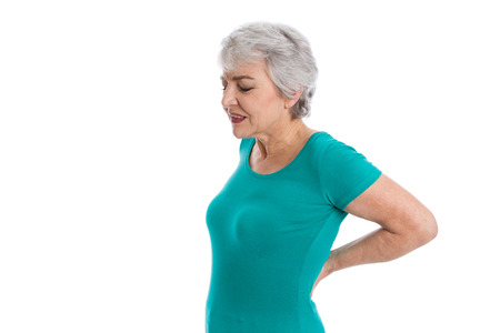 intervertebral disc: Isolated older woman in green shirt with backache.