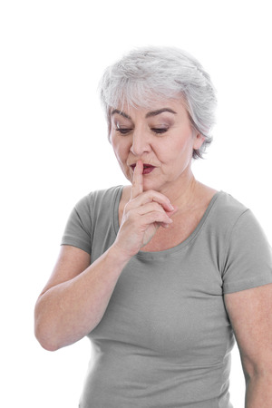 golden ager: Isolated pensive older woman search a solution holding her finger bevore her mouth. Stock Photo