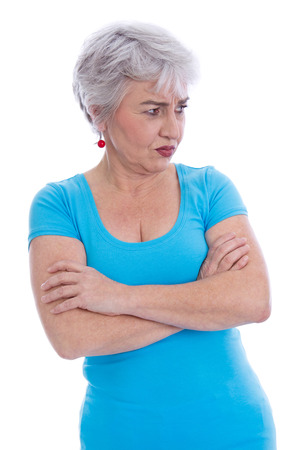 golden ager: Angry pensive older woman looking sideways - isolated over white.