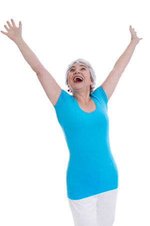 Happy happy older woman isolated in a blue shirt. photo