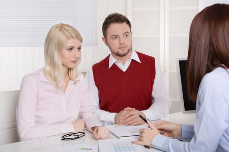 sales bank: Young couple having an appointment at bank or insurance for their future. Stock Photo