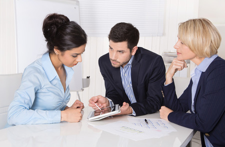 client meeting: Successful business collaboration - man and two woman.