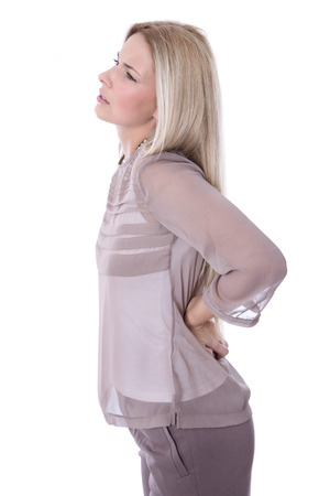 ergonomics: Isolated attractive businesswoman has backache on white background.