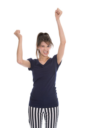 passed: Cheering happy young successful woman with hands up - isolated over white. Stock Photo