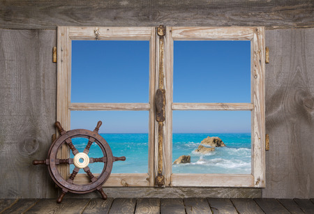 View through wooden window with seascape - holiday concept