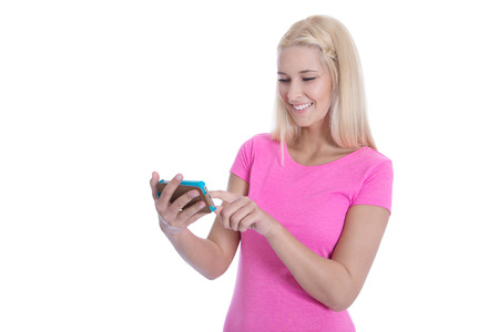 woman searching: Isolated attractive teenager communicating with friends on smartphone over white background