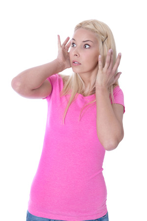 angry blonde: Amazed female student with hands up isolated over white
