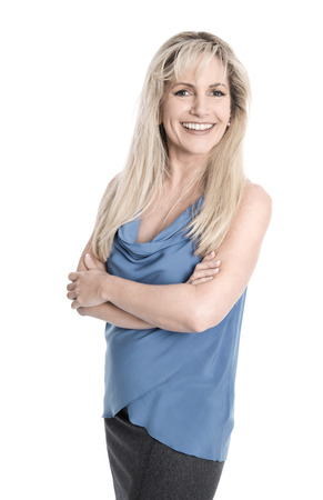 middleaged: Isolated attractive pleased middle aged woman with arms crossed over white. Stock Photo