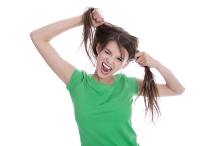 kaput: Shocked and sad woman - broken hair after coloration - split ends. Stock Photo