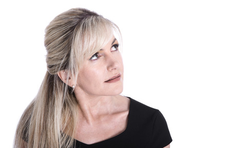 middle age women: Portrait of mature beautiful blond business woman face looking up.