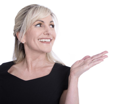 mature woman face: Face of a beautiful older woman looking sideways and presenting with her hand.