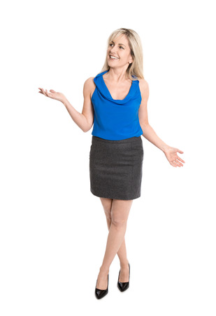 Pretty older isolated woman smiling and gesturing with her hands in full body length. Stock Photo