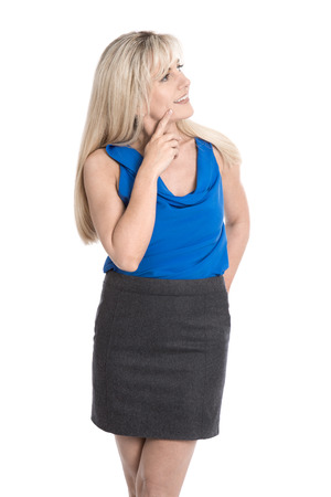consider: Attractive pensive mature woman in summer clothes looking sideways to text. Stock Photo