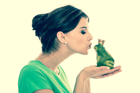 young couple kiss: Dreams of a boyfriend: fairy tale of frog king. Young girl in love. Stock Photo