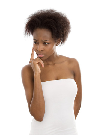 brown skin: Portrait of a sad and disappointed young black woman isolated over white.