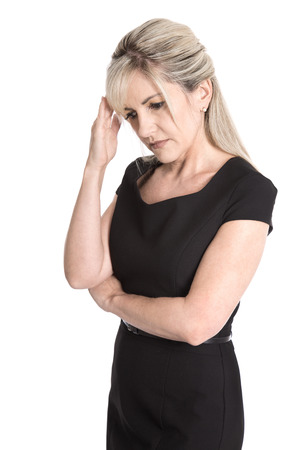 Sad and sorrowful isolated woman in black dress photo