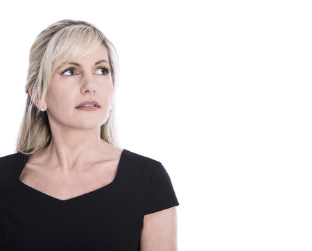 MENOPAUSE: Portrait of isolated mature businesswoman face looking sorrowful and pensive.