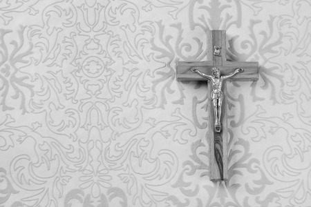 Mourning: Cross on grey ornament  Stock Photo