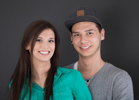 teenage couple: Portrait of a happy young couple in love. Stock Photo