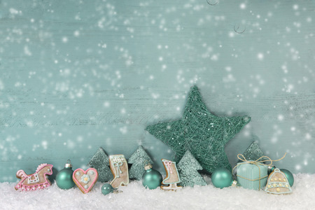Wooden turquoise or mint green christmas background photo