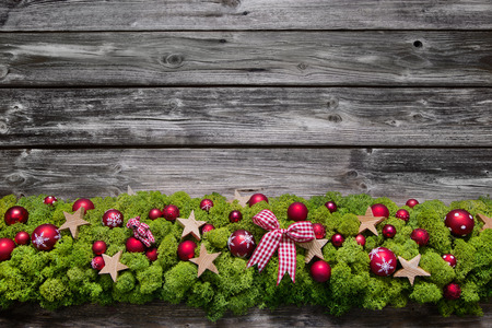 moos: Wooden christmas frame background with green moos and red balls. Stock Photo