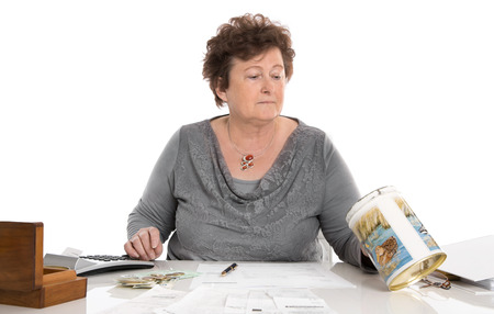 Sad pensioner woman have money problems - poverty in the age concept. photo