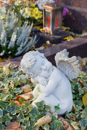 condolence: Autumn decoration on the tomb with a white angel.