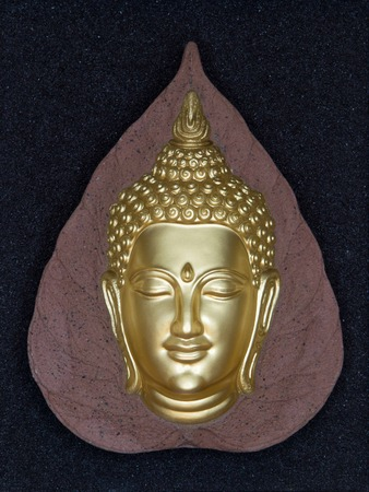 budda: Buddha head in golden colors. Symbol for buddhism. Stock Photo