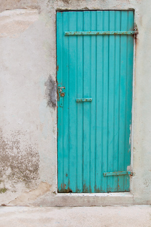 An old wooden turquoise door in a old house  photo