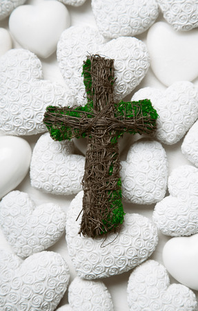 condolence: Mourning or condolence white with a green handmade cross of wood