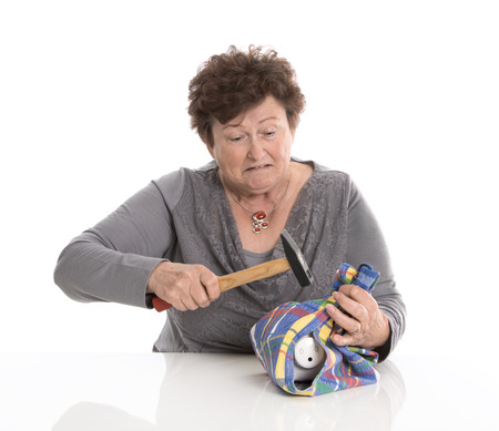 poorness: Poorness of older people in the age - money concept for pension. Stock Photo