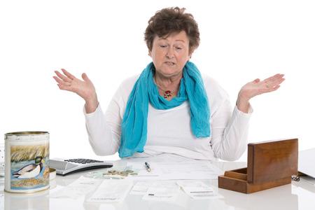 outgoings: Senior portrait: Sad, poor and depressed old woman: Concept pensioner money problems.