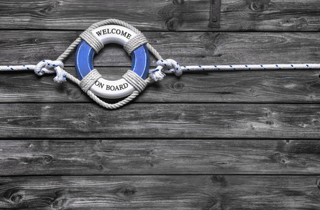 Maritime decoration - life belt on wooden - concept for sailing, cruising or teamwork.