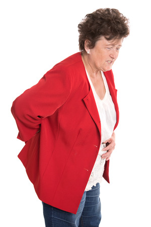 intervertebral disc: Portrait  Isolated female senior in red has backache or rheumatism  Stock Photo