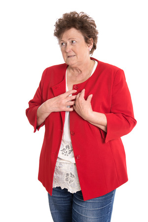 high blood pressure: Portrait of an isolated older woman in red has heart problems