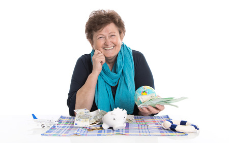 Glad older woman portrait  concept for money and traveling  Stock Photo