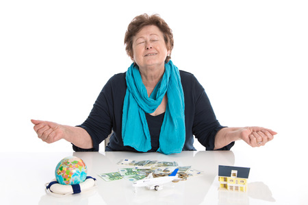 Glad older woman portrait: concept for money and traveling. Stock Photo