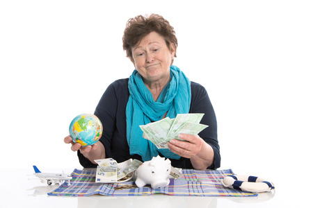 outgoings: Glad older woman portrait: concept for money and traveling. Stock Photo