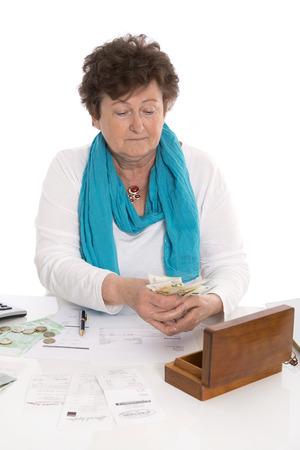 recipient: Senior portrait: Sad, poor and depressed old woman: Concept pensioner money problems.