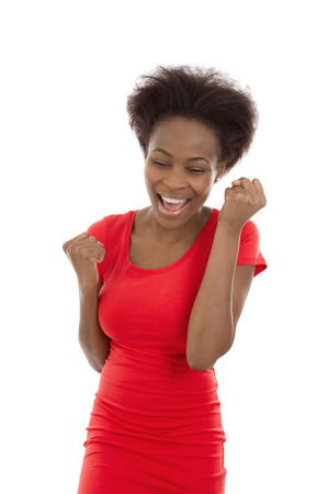 jubilation: Portrait: Isolated cheering and successful young afro american black woman.
