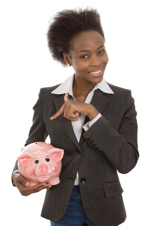 outgoings: Pretty isolated afro american black businesswoman: finance concept with piggy bank.