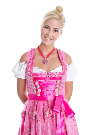 Beautiful young woman isolated on white wearing pink or rose bavarian dress.