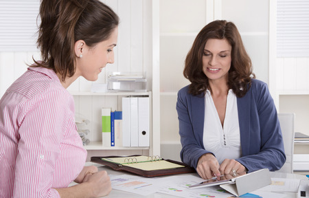 sales bank: Professional business meeting under two woman: customer and adviser.