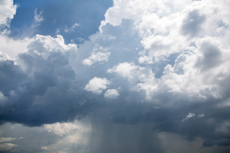 gusty: Horrible clouds in a thunderstorm on the ocean.Blue natural background. Stock Photo