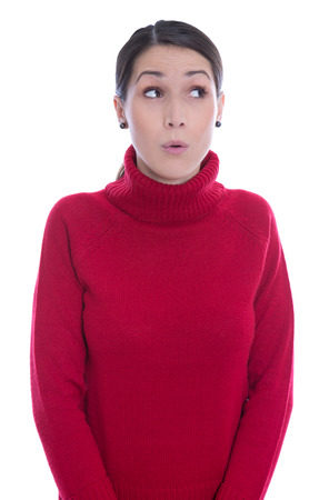 sideways glance: Amazed looking female teenager in red pullover - isolated over white.