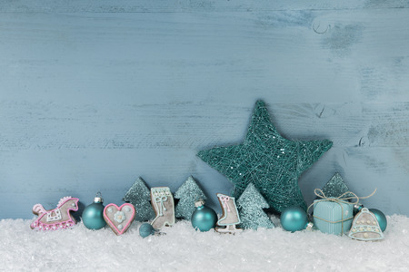 winterly: Winterly wooden blue or mint green christmas background with decoration.