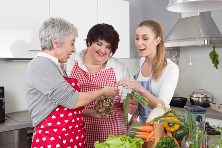Three girlfriends cooking together at home.
